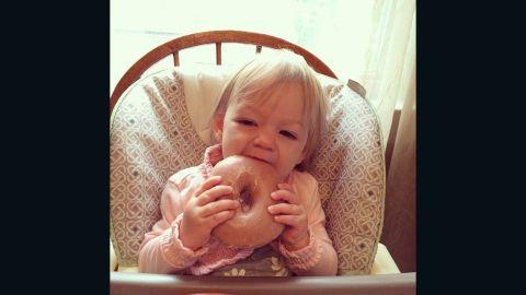 Christine Giuffrida's 14-month-old, Joni Mae, is seen enjoying a first doughnut -- glazed of course!