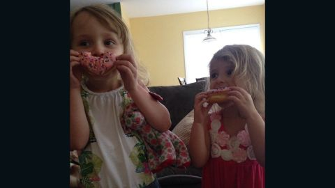 """Instagram user @danniskandishoppe took this photo of her daughters Ayla (on the left) and Eva enjoying a strawberry sprinkled doughnut. Ayla, 5, likes the sprinkles while Eva, 4, says doughnuts are """"yummy!"""""""