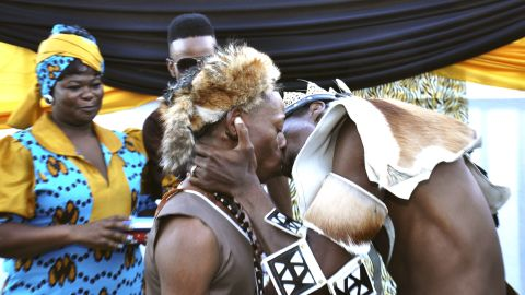 Tshepo Modisane and Thobajobe Sithole kiss at their wedding at Siva Sungum Hall in Kwadukuza, South Africa in April, 2013.