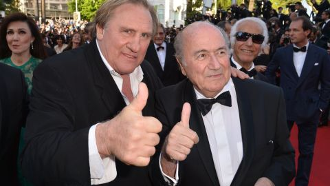 French actor Gerard Depardieu (L) and FIFA President Sepp Blatter give a thumbs-up as they arrive for the screening of the film 'United Passions' at the 67th edition of the Cannes Film Festival in Cannes.