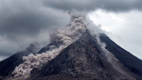 """Thick ash, rock fragments and volcanic gases pour from <a href=""""http://ireport.cnn.com/docs/DOC-1246978"""">Mount Sinabung</a> in Indonesia. The government's natural disaster management agency raised the alert level on June 5, 2015."""