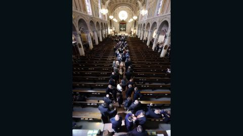 Mourners arrive for the viewing on June 5.