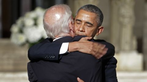 """President Barack Obama hugs Joe Biden after delivering the eulogy on June 6. In his eulogy, Obama credited the vice president with inspiring in his son a devotion to public service and to family, jokingly calling him """"Joe 2.0."""""""