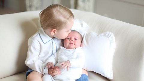 """Charlotte <a href=""""http://www.cnn.com/2015/06/06/europe/uk-royal-princess-charlotte-photos/index.html"""" target=""""_blank"""">is seen with her big brother for the first time</a> in this photo released by Kensington Palace in June 2015."""