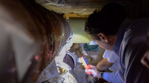 Gov. Cuomo examines a pipe the inmates cut through. Authorities don't know how the prisoners got the power tools.