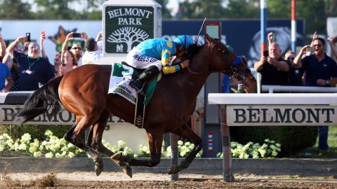 ELMONT, NY - JUNE 06: Victor Espinoza, celebrates atop American Pharoah #5, after winning the 147th running of the Belmont Stakes at Belmont Park on June 6, 2015 in Elmont, New York. With the wins American Pharoah becomes the first horse to win the Triple Crown in 37 years. (Photo by Travis Lindquist/Getty Images)