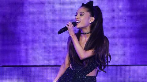 Security footage showed singer Ariana Grande appearing to lick doughnuts in a shop.