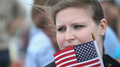 Amanda Bork listens to 2016 Republican presidential hopefuls speak.