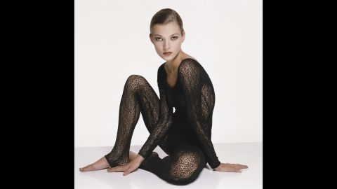 English supermodel Kate Moss, wearing a knitted black body stocking, circa 1993. (Photo by Terry O'Neill/Getty Images)
