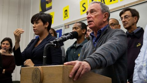 Lydia Callis helps then-Mayor Michael Bloomberg warn New Yorkers about Superstorm Sandy in October 2012.