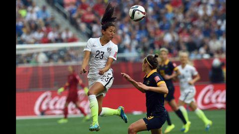 U.S. forward Christen Press heads the ball against Australia. She scored a goal in the second half.