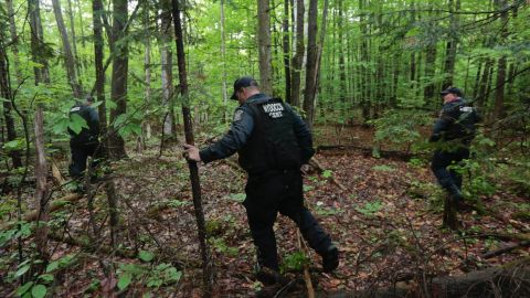 Law enforcement officers search a wooded area in Dannemora on Monday, June 8.