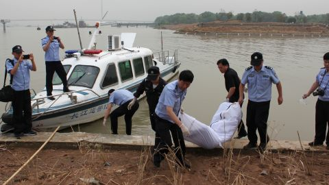 Police carry a body to the shore of the Yangtze River in Nanjing, China, on Tuesday, June 9. The Eastern Star cruise ship sank late Monday, June 1, in stormy weather, with more than 450 passengers and crew on board.