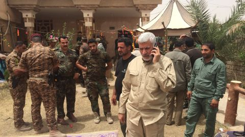 Abu Mahdi Al-Muhandis -- commander of  Hashd Al-Shaabi (PMU) -- takes a call on his satellite phone.