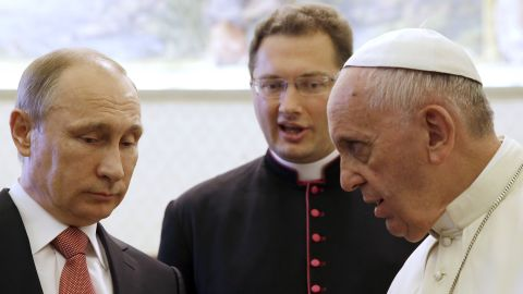 """Russian President Vladimir Putin, left, <a href=""""http://www.cnn.com/2015/06/10/world/putin-italy-visit/index.html"""" target=""""_blank"""">meets Pope Francis</a> at the Vatican on Wednesday, June 10, 2015. The Pope gave Putin a medallion depicting the angel of peace, Vatican spokesman Federico Lombardi said. The Vatican called it """"an invitation to build a world of solidarity and peace founded on justice."""" Lombardi said the pontiff and President talked for 50 minutes about the crisis in Ukraine and violence in Iraq and Syria."""