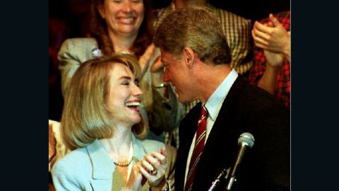 Democratic presidential nominee Bill Clinton is applauded by his wife Hillary on July 1992, before his address to the Women's Caucus of the 1992 Democratic National Convention.