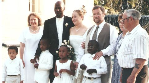 A family photo shows Dolezal's family at her wedding reception in Jackson, Mississippi, on May 21, 2000. Her family is racially mixed; four of her adopted siblings are black. She and her husband, Kevin, are standing between her parents. Her grandparents are at right and her adopted siblings are in the front row.