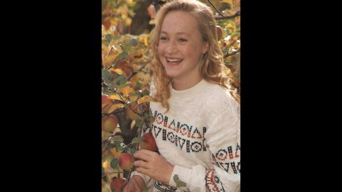 """Another family photo shows Dolezal as a teenager. Her mother <a href=""""http://www.spokesman.com/stories/2015/jun/11/board-member-had-longstanding-doubts-about-truthfu/"""" target=""""_blank"""" target=""""_blank"""">told the Spokane Spokesman-Review</a> that after she and her husband adopted four African-American children, Dolezal began to """"disguise herself."""" Dolezal brushed off the controversy surrounding her racial identity as part of a family fight over alleged abuse, the Spokesman-Review reported."""