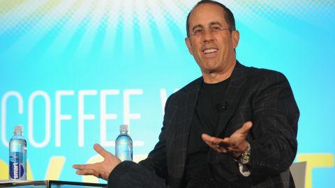 Jerry Seinfeld speaks on stage