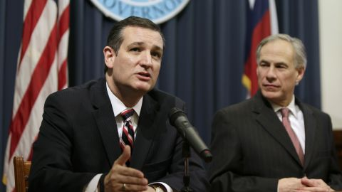 """Sen. Ted Cruz, left, with Texas Gov. Greg Abbott, addresses the <a href=""""http://www.cnn.com/2015/02/17/politics/texas-obama-immigration-injunction/"""">ruling by a federal judge in Texas </a>delaying President Obama's executive action on immigration on February 18. Months later, on June 6, the 2016 presidential hopeful would hold a fund-raiser along the U.S.-Mexico border in McAllen, Texas."""