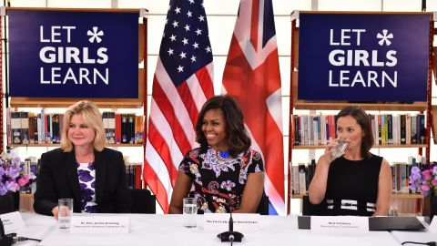 Obama sits between the UK Department of International Development's Justine Greening, left, and Peace Corps volunteer Bina Contreras at the Mulberry School for Girls on June 16.