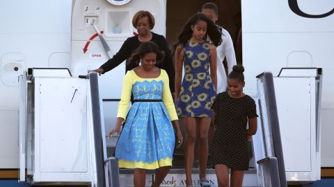 First lady Michelle Obama arrives in London with her daughters -- Sasha, right, and Malia -- and her mother, Marian Robinson, on Monday, June 15. The first lady is in Europe as part of a global tour promoting her Let Girls Learn Initiative.