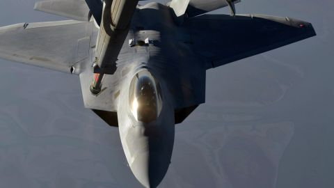 IN FLIGHT - SEPTEMBER 23: In this handout image provided by the U.S. Air Force, A KC-10 Extender refuels an F-22 Raptor fighter aircraft prior to strike operations in Syria, during flight on September 23, 2014. These aircraft were part of a strike package that was engaging ISIL targets in Syria. (Photo by Maj. Jefferson S. Heiland/U.S. Air Force via Getty Images)