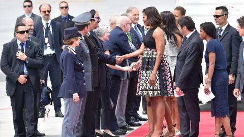 The Obamas shake hands at Milan's Malpensa Airport on June 17.