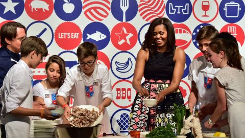 Michelle Obama cooks with children from the American School of Milan on June 17.