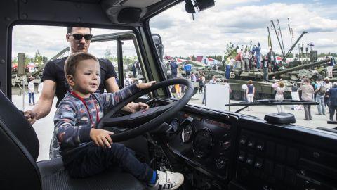 A child climbs inside a Russian army truck.