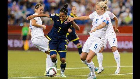 England's Steph Houghton, right, challenges Ingrid Vidal of Colombia during a match in Montreal on June 17. England won 2-1.