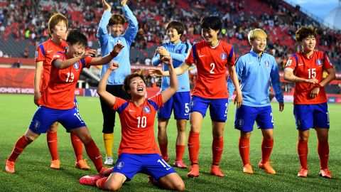 South Korean players celebrate after they defeated Spain 2-1 in Ottawa on Wednesday, June 17.