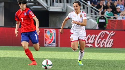 Eunmi Lee of South Korea and Marta Corredera of Spain chase the ball.