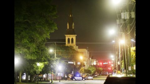 Police in Charleston close off a section of Calhoun Street early on June 18, after the shooting. The steeple of the church is visible in the background.