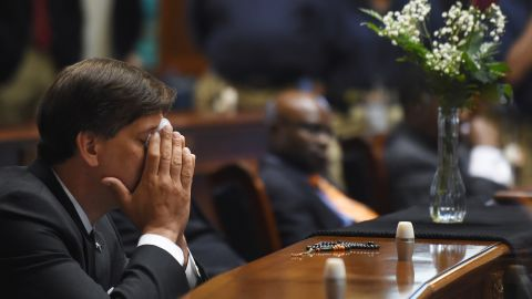 State Senator Vincent Sheheen (D-Kershaw) gets emtional as he sits next to the draped desk of state Sen. Clementa Pinckney, Thursday, June 18, 2015, at the Statehouse in Columbia, S.C.  Pinckney was one of those killed, Wednesday night in a shooting at the Emanuel AME Church in Charleston.  (AP Photo/Rainier Ehrhardt)