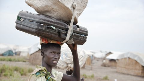 """Nyakong, 22, has been hiding in a village with her family and their cows near Nasir in war-torn South Sudan for months. The village is unsafe, but the floodwaters are too high to bring her three young children to Leitchuor refugee camp in Ethiopia. """"We've survived by just drinking cow's milk,"""" she says. """"Before the war, I was huge, but from lack of food I've got so thin."""""""
