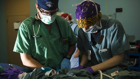An anesthetist and a peri-operative nurse prepare a Guatemalan child for surgery on board the ship.