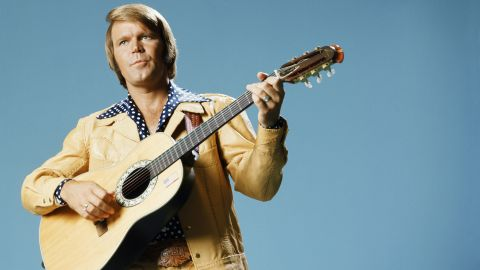 """Glen Campbell, the upbeat guitarist from Delight, Arkansas, whose smooth vocals and down-home manner made him a mainstay of music and television for decades, <a href=""""http://www.cnn.com/2017/08/08/entertainment/glen-campbell-dies/index.html"""" target=""""_blank"""">has died after a lengthy battle with Alzheimer's disease,</a> his family announced on Tuesday, August 8. The six-time Grammy Award winner was 81."""