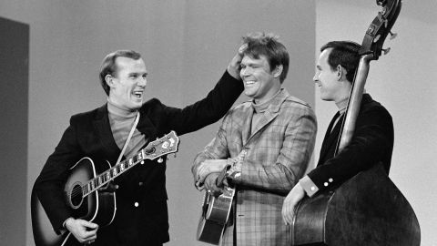 """Campbell became a regular on """"The Smothers Brothers Comedy Hour"""" with Tom, left, and Dick Smothers. In 1968, Campbell became a co-host of the summer replacement series, """"The Summer Brothers Smothers Show,"""" on CBS."""