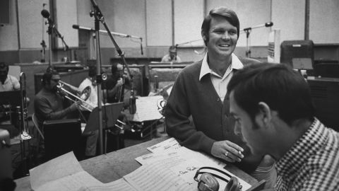 """In the early 1960s, Campbell signed with Capitol Records. Here, he is seen at a recording session with producer Al DeLory, who helped Campbell achieve a number of hit singles and albums including """"Gentle on My Mind"""" and """"By the Time I Get to Phoenix."""""""