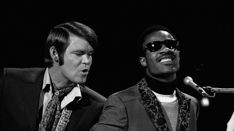 """Campbell's appearances on """"The Smothers Brothers Comedy Hour"""" led to his own own variety series, """"The Glen Campbell Goodtime Hour."""" Here, Campbell performs with Stevie Wonder on the show."""