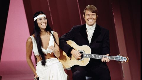 """Cher performs with Campbell on """"The Glen Campbell Goodtime Hour,"""" which aired on CBS from 1969 to 1972. """"Gentle on My Mind"""" was the theme song of the show."""