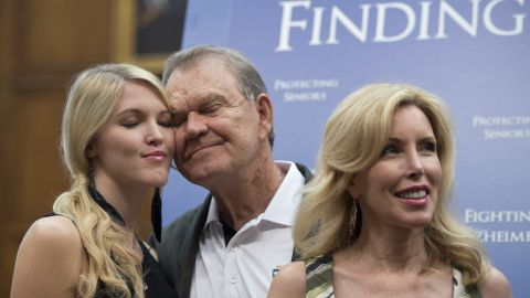 Campbell hugs his daughter Ashley, left, as they attend a 2012 news conference with US Sen. Edward Markey, co-chairman of the Congressional Task Force on Alzheimer's Disease. The Campbell family has advocated for awareness and research on the disease.