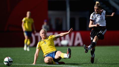 Germany's Anja Mittag takes a shot past Linda Sembrant.