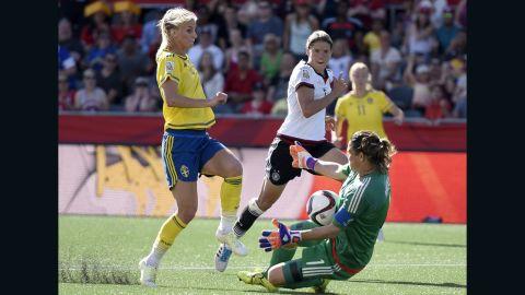 German goalkeeper Nadine Angerer makes a save against a charging Jakobsson.