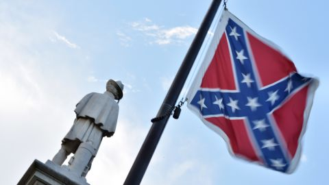 The Confederate flag is seen next to the monument of the victims of the Civil War in Columbia, South Carolina on June 20, 2015.