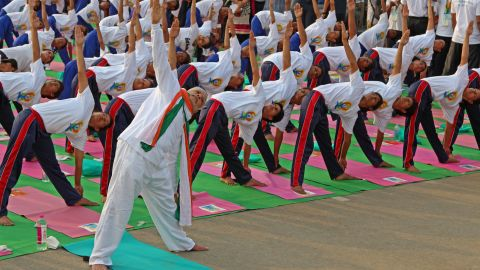 Here Modi shows his flexibility for the cameras. In the days leading up to the event, he was tweeting yoga moves to his 13 million followers.