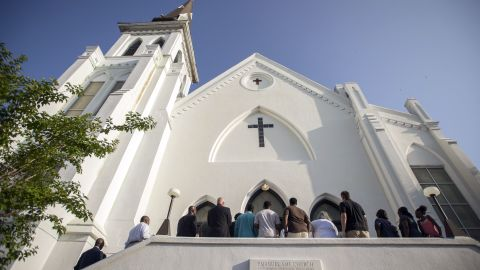 People line up to enter the Emanuel African Methodist Episcopal Church before a worship service, Sunday, June 21 in Charleston, South Carolina. It is first service at the church since a racially motivated shooting killed nine people there on Wednesday, June 17.