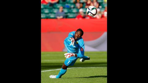 Cameroon goalkeeper Annette Ngo Ndom saves a shot on goal.