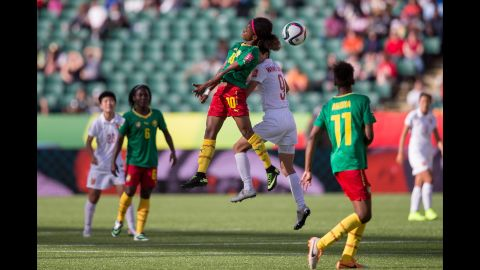 Cameroon's Jeannette Yango and China's Wang Shanshan compete for a header.